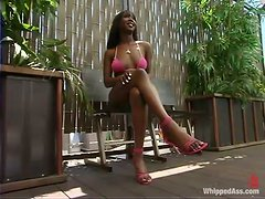 Ebony babe gets dominated by redhead babe outdoors