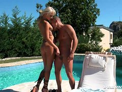 Magnificent Ivana Sugar shows her handjob talents by the pool