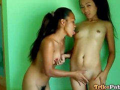Lesbian Asian teens fondle each other lustily