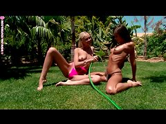 Teen lesbians get wet and sexy in the grass