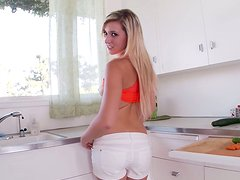 Appetizing blonde babe is tossing her own salad in the kitchen