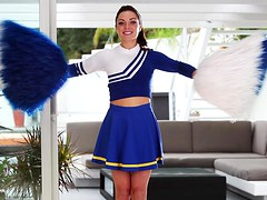 Stunning Gigi Marie poses in cheerleader uniform