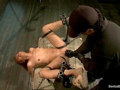 Yasmine de Leon gets banged by a fucking machine while being in chains