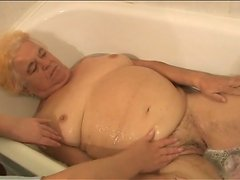 Nurse bathes granny and rubs her cunt