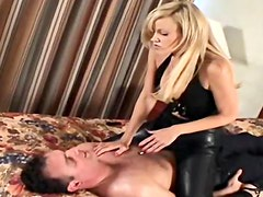 Leather mistress spanks him in hotel room