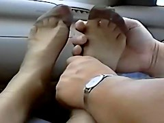 Footjob in the car with pretty girl