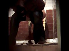 Gorgeous and hot brunette is pissing in the toilet