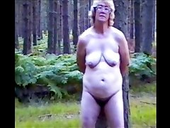 Mature Amy Handcuffed Naked to a Tree