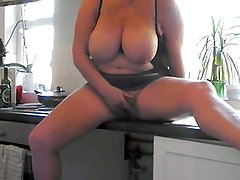 Playing on the kitchen counter
