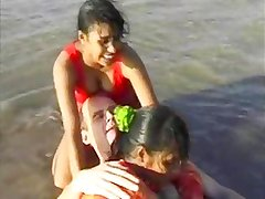 2 Indian girls with white guy in beach have fun blowjob..