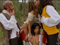 Two horny couples in costumes enjoy foursome banging outdoors