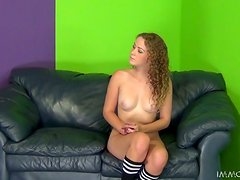 Curly-haired hottie Kimber Day rubs a cock and gets her snatch smashed