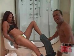 Midget gets his black cock sucked in bathroom