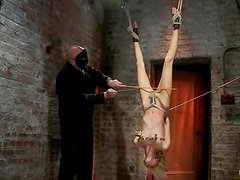 Gorgeous Rene Phoenix is being suspended upside down