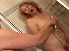 Mature hoochie is having sex fun with young guy in the shower