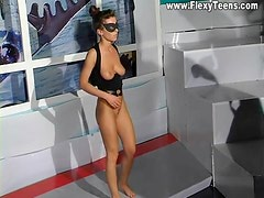Masked gymnast bends her nude body sensually