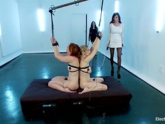 Two brown-haired babes get toyed in all holes by two mistresses