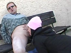 Renate gives a deep blowjob outdoors