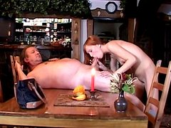 Sexy redhead gets banged by a fat guy on the table