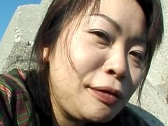 Asian beauty is drilling her lovely hairy snatch