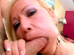 Voluptuous mom blowing a hard cock