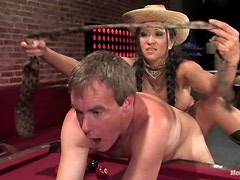 Kitty Langdon rides Wild Bill's prick after smashing his ass with a toy
