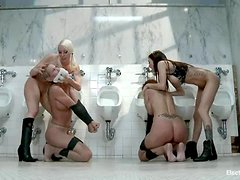 Two submissive girls get dominated by two chicks in a toilet