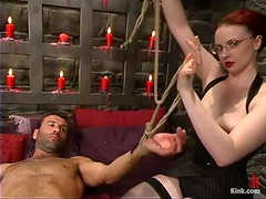 Claire Adams enjoys pulling some dude by the cock in BDSM scene