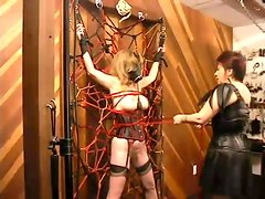 Blonde chick in a gas mask gets dominated by her mistress