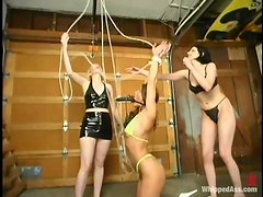 Two sexy babes in bikini get their asses whipped by a mistress