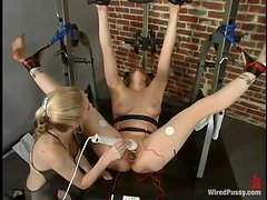 Superb Adrianna Nicole gets dominated in a gym by another babe