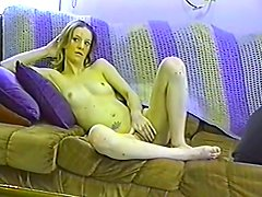 Alone On The Sofa Rubbing Her Shaved Vagina With Big Dildo