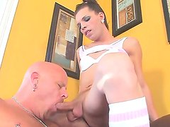 Hot and arousing dark haired shemale Lexi Wade enjoys in getting her hard bazooka sucked