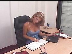 Horny shemale shoves a dildo up her ass in the office