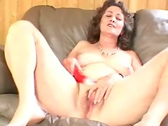 Elderly lady Vicky moans loudly while fucking her vag with a dildo
