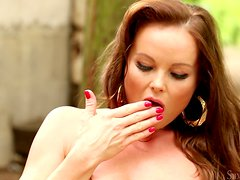 Charming Silvia Saint plays with her hot pussy in a park
