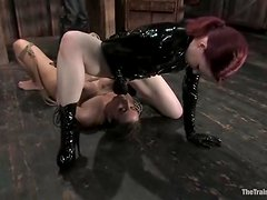 Oily blondie gets suspended and fucked with a strapon