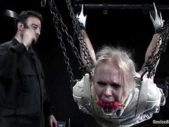Blonde in straitjacket and gas mask gets humiliated