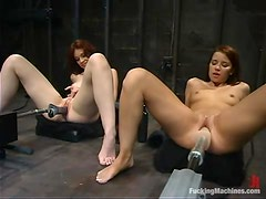Justine Joli and Sarah Blake get fucked by sex machines in a basement