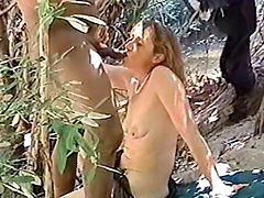 A kinky bitch gets her cunt torn up by a black stud in the forest