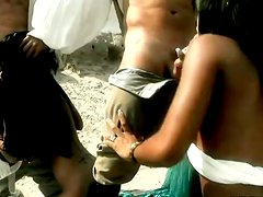 Black Angelika and Kyra Black get fucked hard in a sandy place