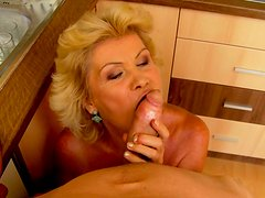 Blond mommy sucked a large cock of her son's friend