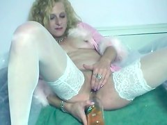 Horny and drunk Anna pokes a bottle into her wet pussy