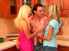 A lucky dude fucks Carla Cox and Mia Hilton in the kitchen
