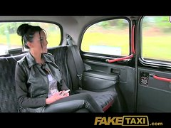 Busty brunette chick is riding a taxi driver's dick