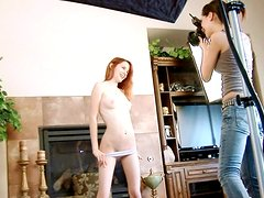 Redhead Emilie is posing topless