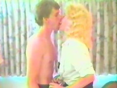 Curly blonde cougar gets fucked in retro video