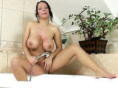 Laura Lion with gigantic knockers and bald bush gets