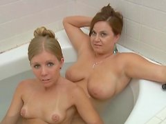 Two lesbian milfs are having fun in the bathtub