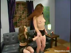Audrey Leigh torments Carly and pours wax on her belly and pussy